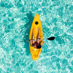 Woman in a yellow kayak
